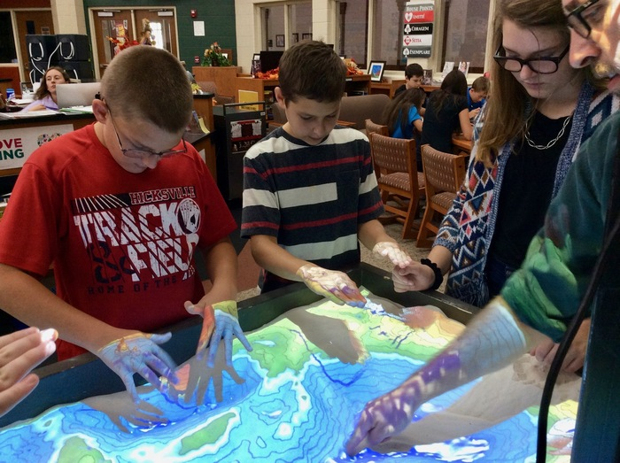 Science 7 students explore how to make virtual rain while using the sandbox.