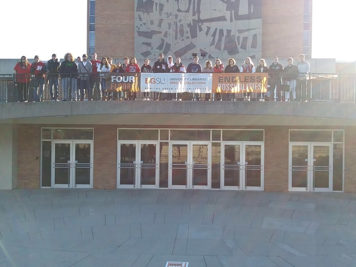 Students stand outside of the BGSU Jerome Library.