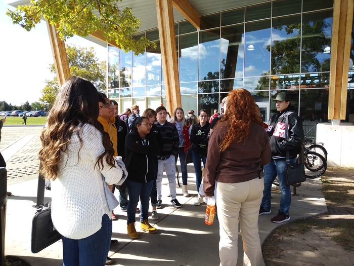 Students listen carefully as Jackie Siebenaler, Hicksville grad, now BGSU senior, shows them the campus.