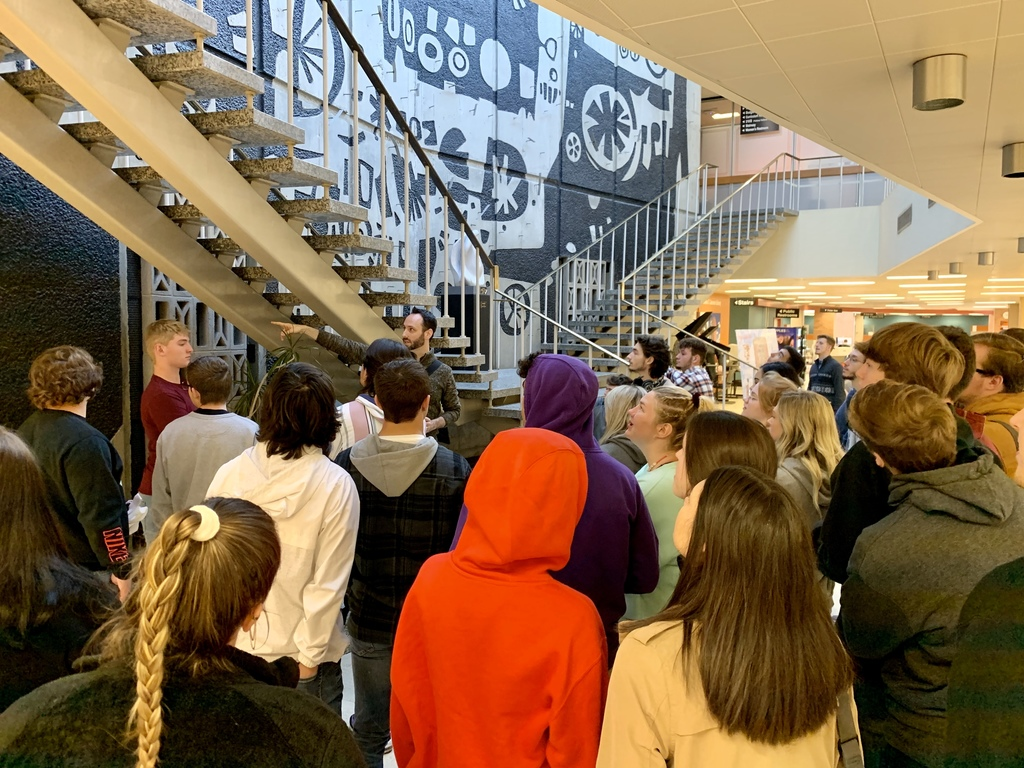 Seniors learn of the history behind the famous BGSU Jerome Library mural.