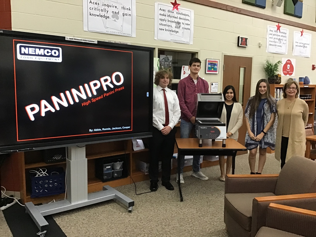 Student presenters with NEMCO Food Equipment President Michelle Wibel.